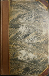 Front cover of vol. I. Marbled, half leather.